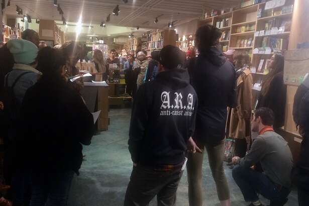 "Pro-immigration activists speak at a Feb. 19, 2018 book signing for Francisco Cant�, a former Border Patrol Agent and the author of ""The Line Becomes a River,"" at Green Apple Books on the Park."