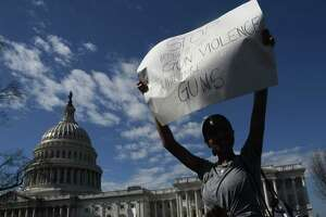 A student hoists a sign as hundreds of high school and middle school students from the District of Columbia, Maryland and Virginia staged walkouts and gathered Wednesday in front of the Capitol in support of gun control in the wake of the Florida shooting. / AFP PHOTO / Olivier DoulieryOLIVIER DOULIERY/AFP/Getty Images