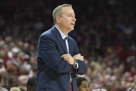 Texas A&M coach Billy Kennedy watches the team play Arkansas during the first half of an NCAA college basketball game Saturday, Feb. 17, 2018, in Fayetteville, Ark. (AP Photo/Michael Woods)