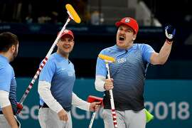 From left, U.S. curlers John Landsteiner, John Shuster and Matt Hamilton celebrate their victory over  Canada in a men's curling semifinal match in Gangneung, South Korea, on Thursday, Feb. 22, 2018. The U.S. team, on the brink of elimination for much of the 2018 Winter Olympics, withstood enormous pressure to defeat Canada, 5-3. (Jeffrey Furticella/The New York Times)