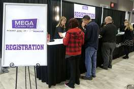 People register Wednesday February 21, 2018 at the Mega Career Fair at the Norris Conference Center on Loop 410. Twenty six companies were represented at the event offering employment in manufacturing, transportation, health care and more.