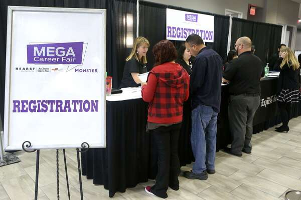 People register Wednesday February 21, 2018 at the Mega Career Fair at the Norris Conference Center on Loop 410. San Antonio can boast a lower than average cost of living, but it's also a city where workers get paid less, data from the Bureau of Labor Statistics show.