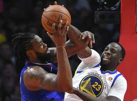 Draymond Green #23 of the Golden State Warriors defends a shot by DeAndre Jordan #6 of the Los Angeles Clippers in the second half of the game on January 6, 2018 in Los Angeles, California.