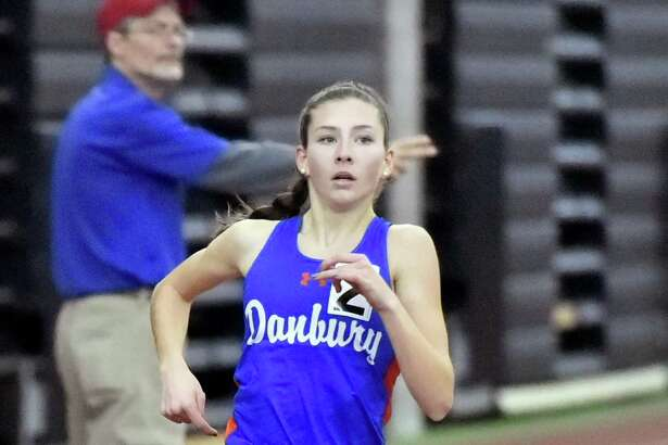 Girls 1,600 meter winner Lauren Moore of Danbury High School runs her second lap en route to a victory in the State Class LL Girls and Boys Indoor Track and Field Championship at the Floyd Little Athletic Center in New Haven on Saturday, February 10.