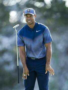 PALM BEACH GARDENS, FL - FEBRUARY 22: Tiger Woods flips his club after a putt on the 15th green during the first round of the Honda Classic at PGA National Resort and Spa on February 22, 2018 in Palm Beach Gardens, Florida. (Photo by Sam Greenwood/Getty Images)