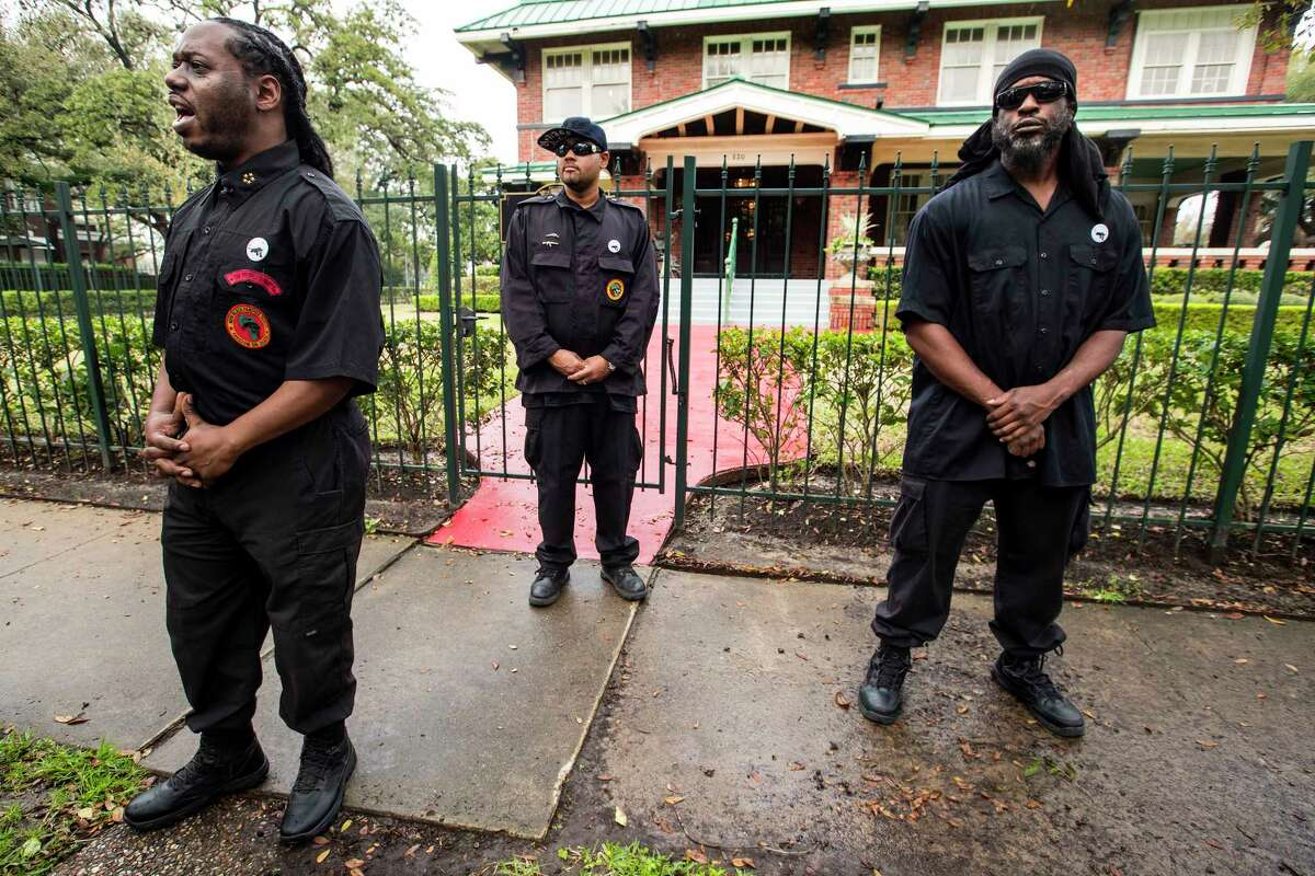 Yahcanon Ben Yah, national chairman of the New Black Panther Party, left, stands with James Jones, center, and Maitreya Ahsekh, outside the Hall Law firm as they hold a news conference distancing the group from activist Quanell X on Thursday, Feb. 22, 2018, in Houston.