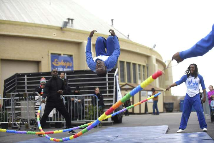 The Chicago Boyz Acrobatic Team performs at the San Antonio Stock Show & Rodeo on Thursday. If weather permits, performances will continue each day through Sunday outside Freeman Coliseum.