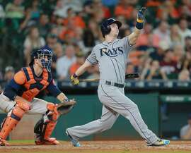 HOUSTON, TX - AUGUST 28:  Corey Dickerson #10 of the Tampa Bay Rays hits a three-run home run in the eighth inning against the Houston Astros at Minute Maid Park on August 28, 2016 in Houston, Texas.  (Photo by Bob Levey/Getty Images)