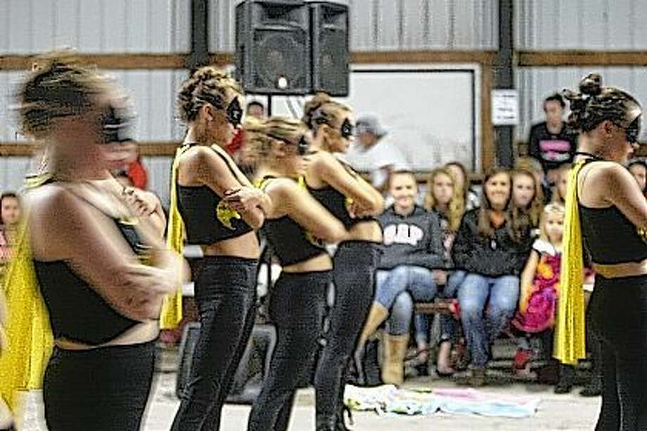 Members of Sara's Dance Studio in Jacksonville perform a Batman-themed hip-hop dance Wednesday at the Morgan County Fair Talent Show. The group took first place in the senior division of the competition. Photo: Samantha McDaniel-Ogletree | Journal-Courier