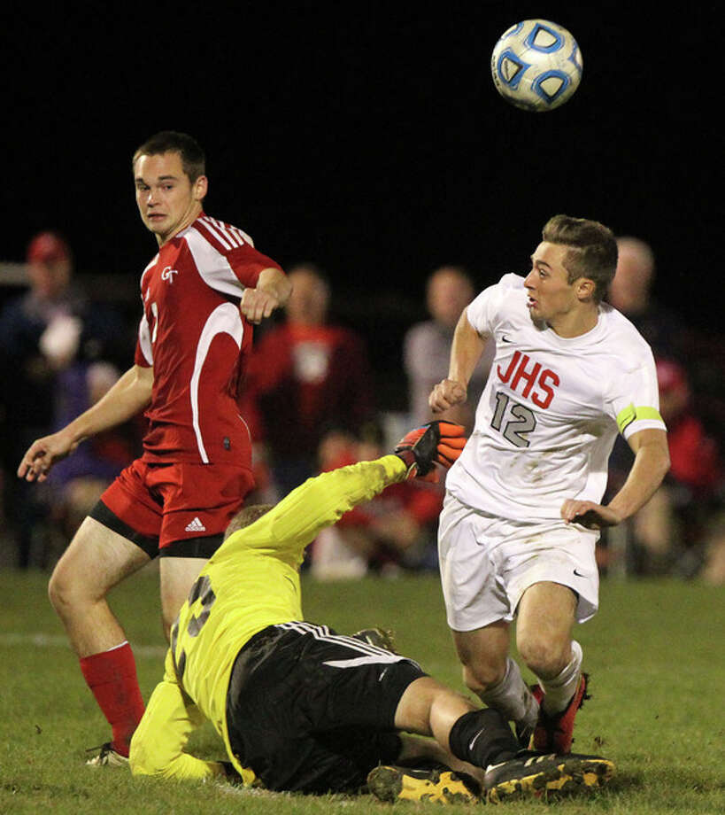 Jacksonville's Ty Rogers (right) battles a goalkeeper during a match last season.