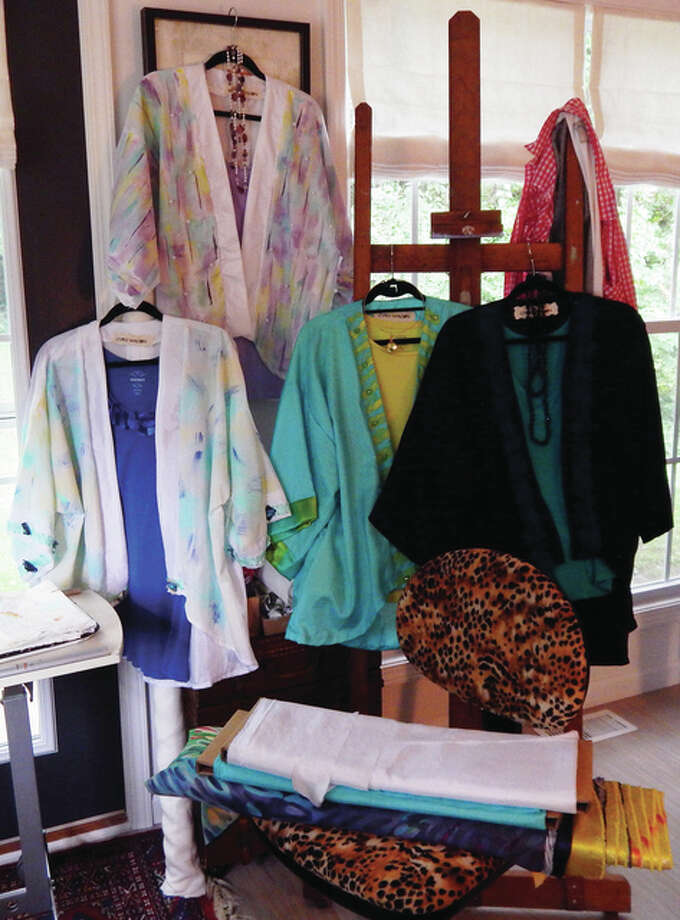 A cluster of kimono-style jackets hangs in Toni Long's Jacksonville home, awaiting display at the A. Pratt Gallery and Studio in downtown Jacksonville.