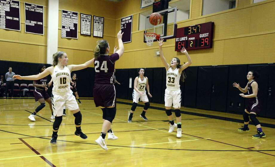 St. Luke's Maya Klein (24) opts out of a three point shot to pass off to teammate McKenna Frank (10) during a FAA girls basketball championship semi-final game against Greenwich Academy at St. Luke's School on Thursday, Feb. 22, 2018 in New Canaan, Connecticut. Photo: Matthew Brown / Hearst Connecticut Media / Stamford Advocate