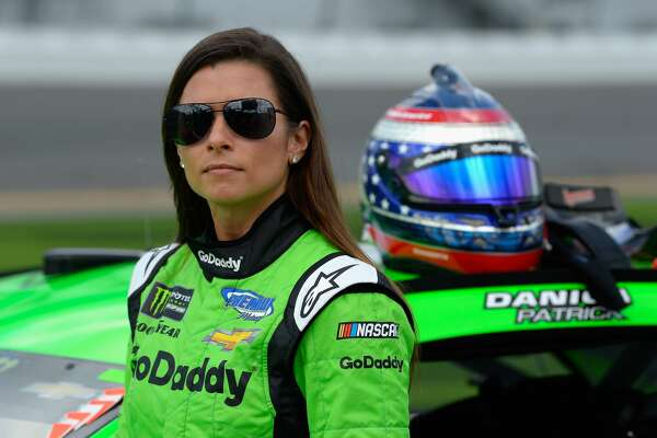DAYTONA BEACH, FL - FEBRUARY 11:  Danica Patrick, driver of the #7 GoDaddy Chevrolet, stands by her car during qualifying for the Monster Energy NASCAR Cup Series Daytona 500 at Daytona International Speedway on February 11, 2018 in Daytona Beach, Florida.  (Photo by Robert Laberge/Getty Images)