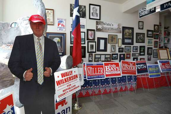 A cardboard cutout of President Trump stands inside the Montgomery County Republican Party headquarters in Conroe, along with various yard signs for Republicans running for office in Montgomery County. ( Karen Warren / Houston Chronicle )