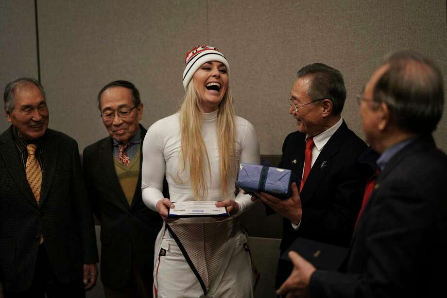 Lindsey Vonn shows her joy after receiving gifts and a letter of appreciation for her grandfather's service during the Korean War from members of the Yongsan Club in Jeongseon, South Korea. Photo: Felipe Dana, STF / Copyright 2018 The Associated Press. All rights reserved