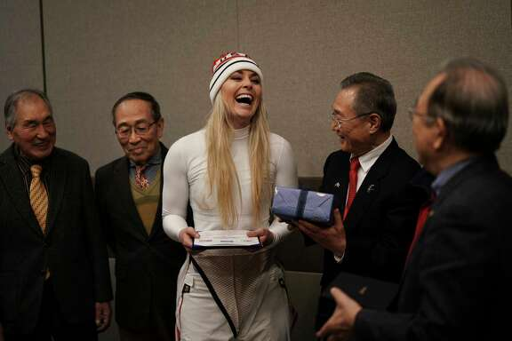 United States' Lindsey Vonn, center, smiles as she receives gifts and a letter of appreciation for her grandfather's service during the Korean War from members of the Yongsan Club in Jeongseon, South Korea, Thursday, Feb. 22, 2018. (AP Photo/Felipe Dana)