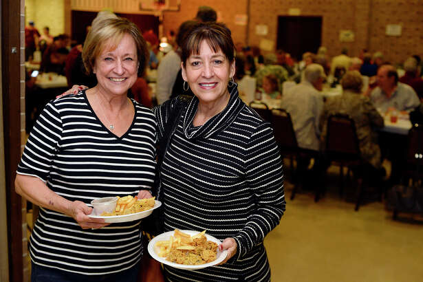 Sara Moon and Alba Santiago at First United Methodist Church's oyster supper on Thursday evening. The annual event began in the late 1950s and serves as a fundraiser for the church's charitable missions. Causes helped by the funds include Some Other Place, Habit for Humanity, The Rainbow Room and others. The church ordered 80 containers of oysters and used 100 pounds of cornmeal and 50 pounds of flour to keep the fryers busy. Photo taken Thursday 2/22/18 Ryan Pelham/The Enterprise