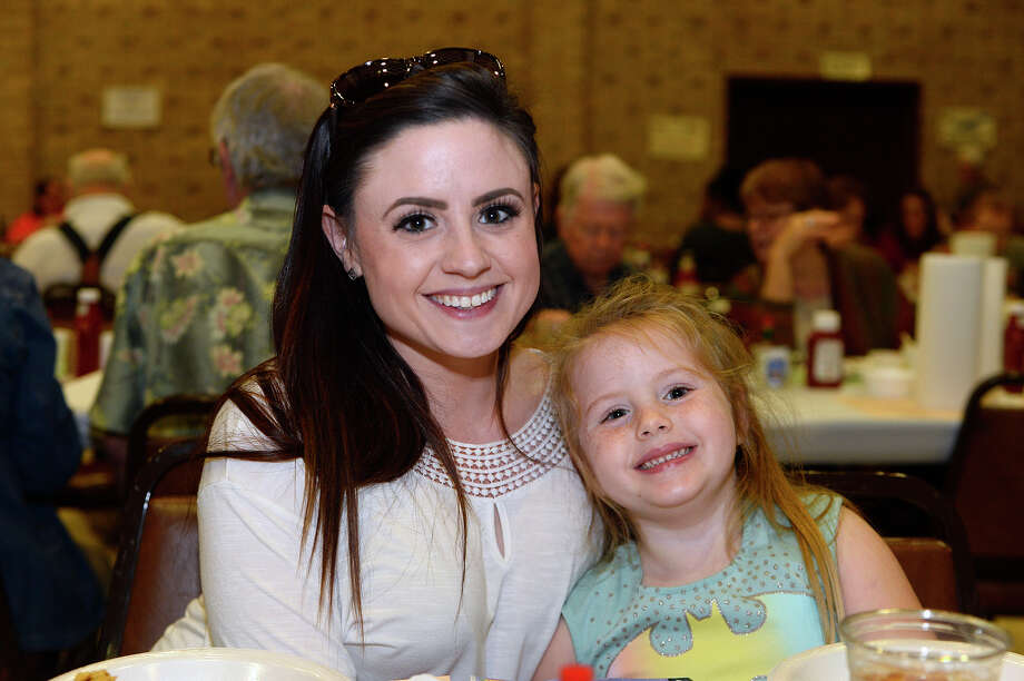 Samantha and Paisley Joyner at First United Methodist Church's oyster supper on Thursday evening. The annual event began in the late 1950s and serves as a fundraiser for the church's charitable missions. Causes helped by the funds include Some Other Place, Habit for Humanity, The Rainbow Room and others. The church ordered 80 containers of oysters and used 100 pounds of cornmeal and 50 pounds of flour to keep the fryers busy. Photo taken Thursday 2/22/18 Ryan Pelham/The Enterprise Photo: Ryan Pelham / ©2017 The Beaumont Enterprise/Ryan Pelham