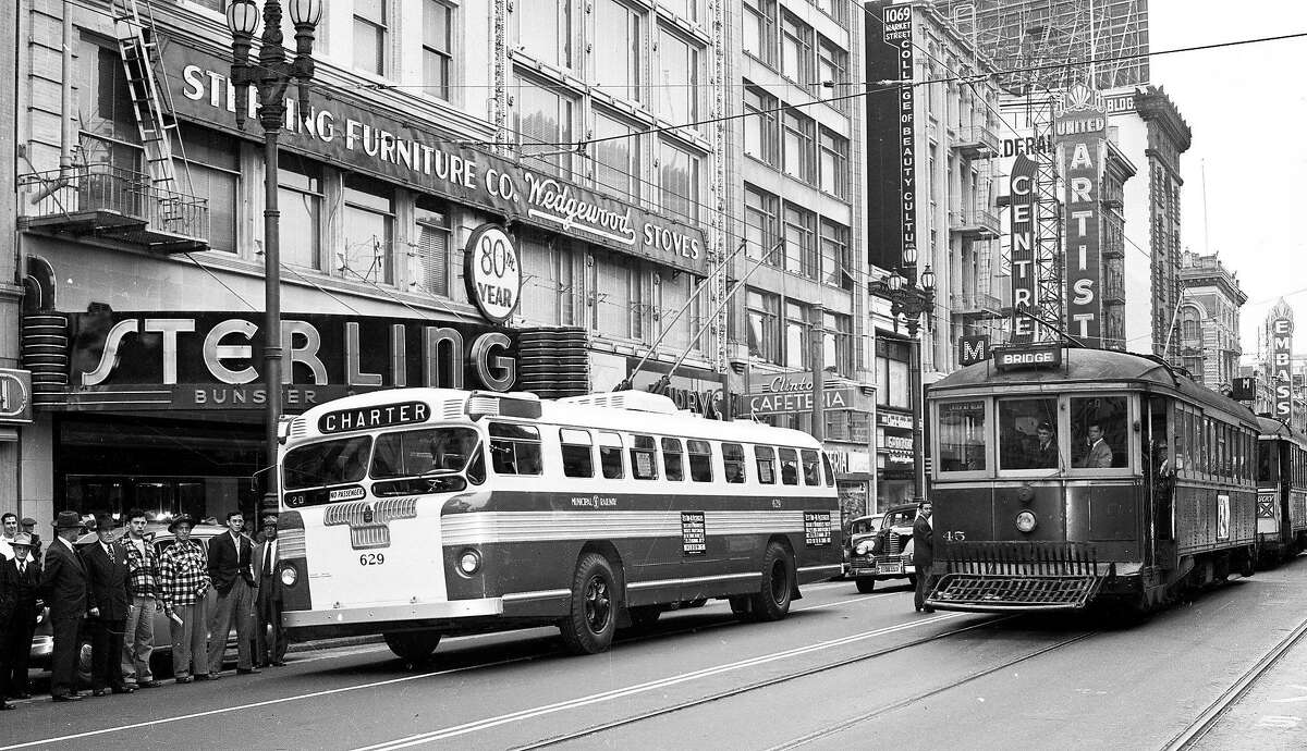 June 4, 1949: The first Municipal Railway electric bus is hooked up on Market Street near near theater row.