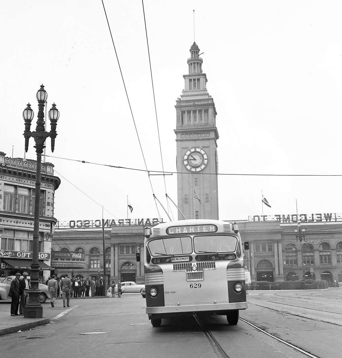 June 4, 1949: The first Municipal Railway electric bus is hooked up on Market Street near the Ferry Building.