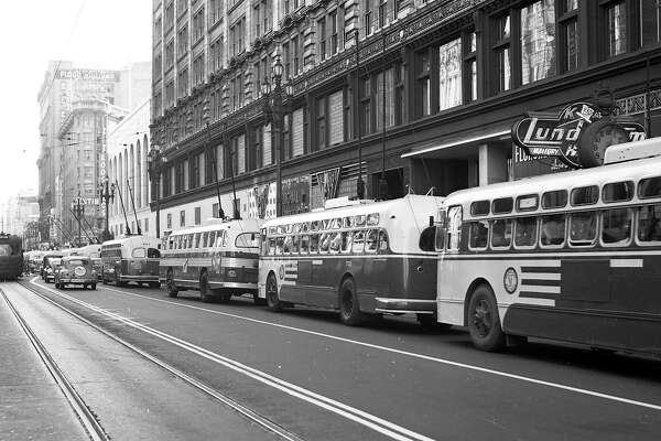 "July 5, 1949: A row of new Municipal Railway electric ""trackless trolley"" buses wait for service on Market Street in San Francisco."