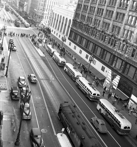 "A row of new Municipal Railway electric ""trackless trolley"" buses wait for service on Market Street in San Francisco. Photo: Bob Campbell, The Chronicle"