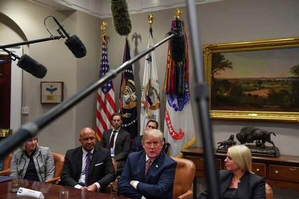 President Trump discusses gun policy at White House on Thursday, with, from left to right, Pam Stewart, commissioner of the Florida Department of Education; Indiana Attorney General Curtis Hill; and Florida Attorney General Pam Bondi.