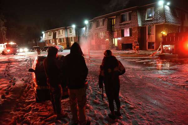 Displaced residents watch firefighters battle a fire at Hudson Terrace Apartments on Thursday, Feb. 22, 2018 in Troy, N.Y. (Lori Van Buren/Times Union)