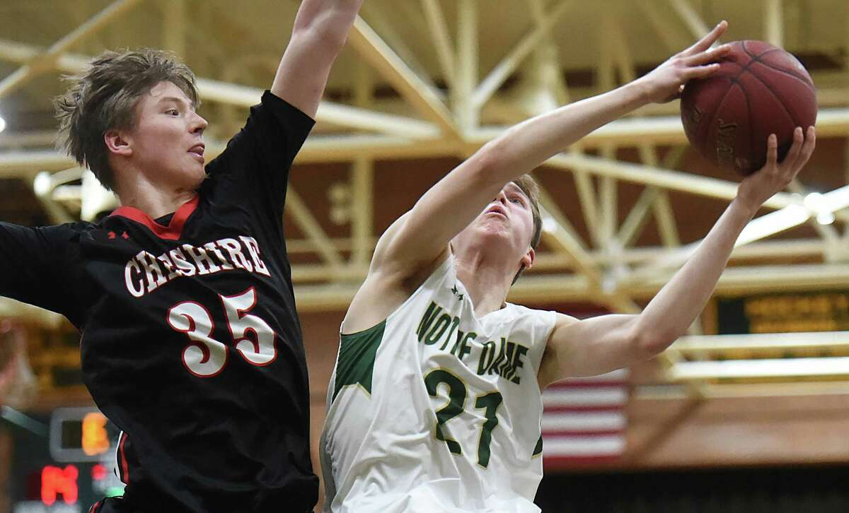 Notre Dame - West Haven sophomore guard Zach Laput elevates in the paint as Cheshire sophomore Aidan Godfrey defends Thursday, Feb. 22, 2018, in the first-round of the SCC tournament at Notre Dame High School in West Haven. Notre Dame won, 63-34.