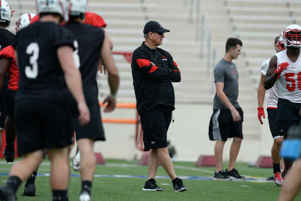 Lamar head football coach Mike Schultz watches as players warm up during the first football practice of the year on Thursday.  Photo taken Thursday 2/22/18 Ryan Pelham/The Enterprise