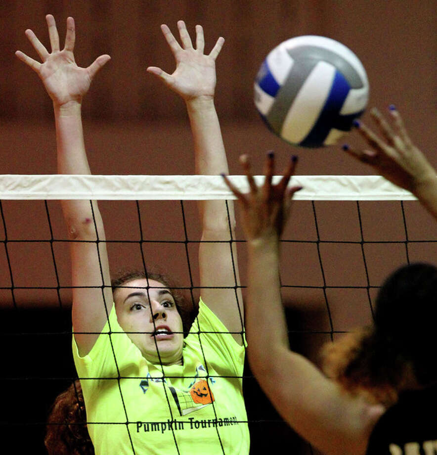 Jacksonville's Shae Upton reaches up for a block during a match in the MacMurray College summer volleyball league earlier this summer. Photo: Dennis Mathes | Journal-Courier