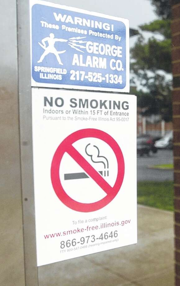 "One of the ""no smoking"" stickers that can be found on the Illinois College campus. Photo: Nick Draper 