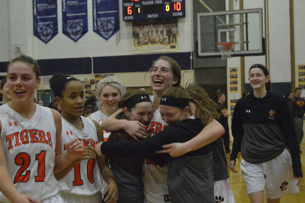 Edwardsville players celebrate after Thursday's overtime victory over Rock Island in the championship game of the Class 4A Champaign Centennial  Sectional.