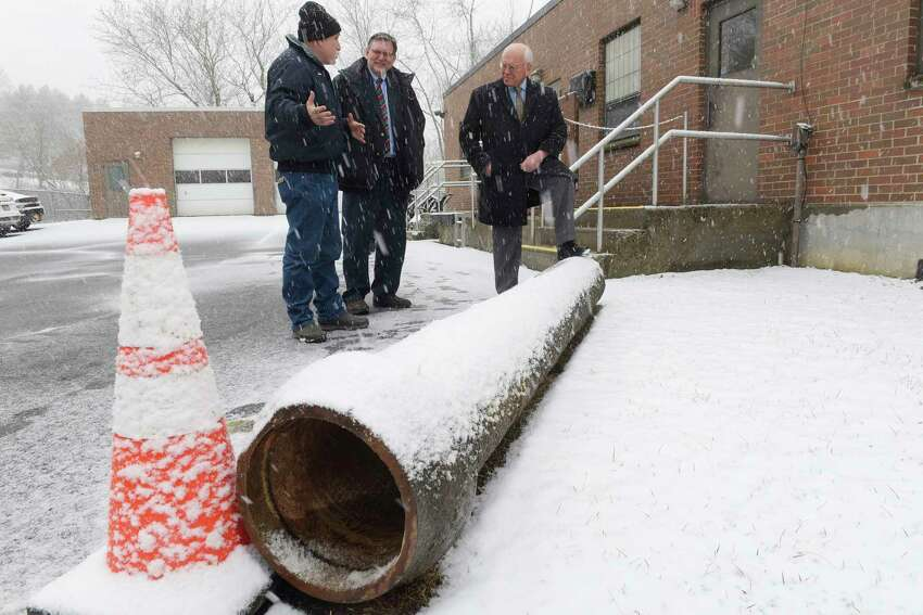 John Shortsleeve, left, the Village of Castleton water superintendent, village Mayor Robert Schmidt, center, and Congressman Paul Tonko talk about the aging water pipes during a visit to the water treatment plant on Thursday, Feb. 22, 2018, in the Village of Castleton, N.Y. On the ground is a section of pipe that was installed in 1969 and cracked and had to be replaced. (Paul Buckowski/Times Union)