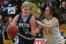 Claire Gulbin (11) of the Wilton Warriors drives to the basket during the FCIAC championship game against the Trumbull Eagles at Fairfield Ludlowe High School on Thursday February 22, 2018 in Fairfield, Connecticut.