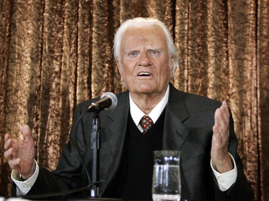 (FILES) In this file photo taken on June 21, 2005 Evangelist Billy Graham takes questions at a  press conference in New York to announce his Billy Graham Crusade. The body of Reverend Billy Graham, a spiritual advisor to several presidents, will lie in the US Capitol Rotunda next week so Americans can pay respect to the globally influential preacher, lawmakers said February 22, 2018.The rare honor of placing an American's remains in the Capitol is usually reserved for US presidents, military officials and politicians.  Graham, who died February 21, 2018 at age 99, would be only the fourth private citizen so honored, and the first person since US senator Daniel Inouye in 2012.  / AFP PHOTO / Timothy A. CLARYTIMOTHY A. CLARY/AFP/Getty Images Photo: TIMOTHY A. CLARY / AFP or licensors