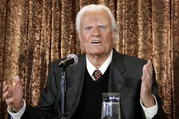 (FILES) In this file photo taken on June 21, 2005 Evangelist Billy Graham takes questions at a  press conference in New York to announce his Billy Graham Crusade. The body of Reverend Billy Graham, a spiritual advisor to several presidents, will lie in the US Capitol Rotunda next week so Americans can pay respect to the globally influential preacher, lawmakers said February 22, 2018.The rare honor of placing an American's remains in the Capitol is usually reserved for US presidents, military officials and politicians.  Graham, who died February 21, 2018 at age 99, would be only the fourth private citizen so honored, and the first person since US senator Daniel Inouye in 2012.  / AFP PHOTO / Timothy A. CLARYTIMOTHY A. CLARY/AFP/Getty Images