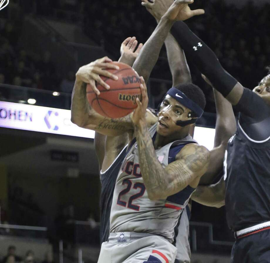 UConn's Terry Larier grabs rebound during the first half against Cincinnati on Thursday in Highland Heights, Ky. Photo: Tony Tribble / Associated Press / TONY TRIBBLE