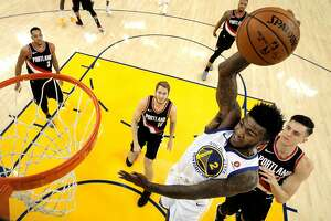Jordan Bell dunks the ball during the second half as the Golden State Warriors played the Portland Trail Blazers at Oracle Arena in Oakland, Calif., on Monday, December 11, 2017.