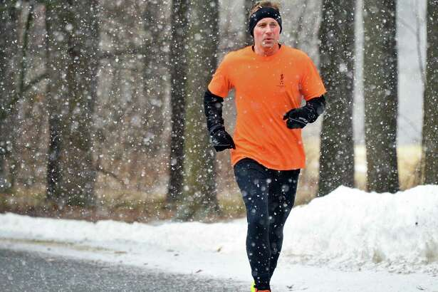 Zak Hill of Saratoga Springs takes a run through Saratoga Spa State Park as snow begins to fall Thursday Feb. 22, 2018 in Saratoga Springs, NY.  (John Carl D'Annibale/Times Union)