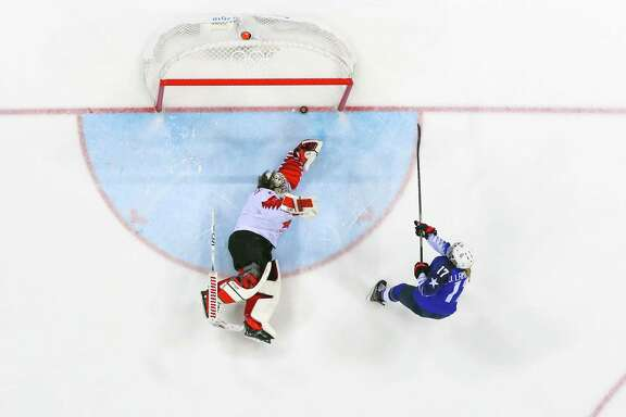 The United States' Jocelyne Lamoureux-Davidson had all the right moves to get her shot in the sixth round of the shootout past Canadian goalie Shannon Szabados.