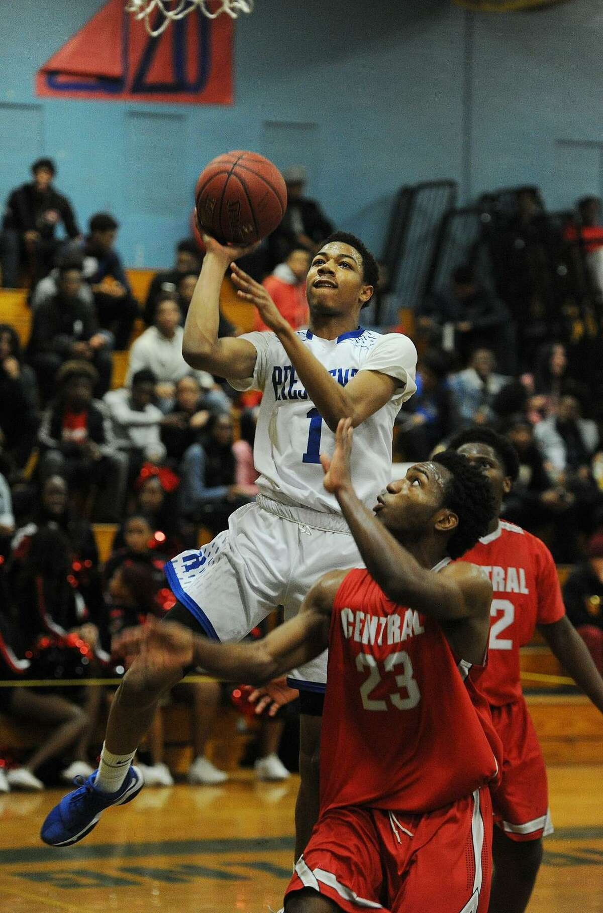 Harding's Keith Bush drives to the basket ahead of Bridgeport Central defender Raj Walker in the first half of their boys basketball game at Harding High School in Bridgeport, Conn. on Thursday, February 22, 2018. The game was the final regular season game to be played at Miska Gymnasium as the new Harding High School will open next fall.
