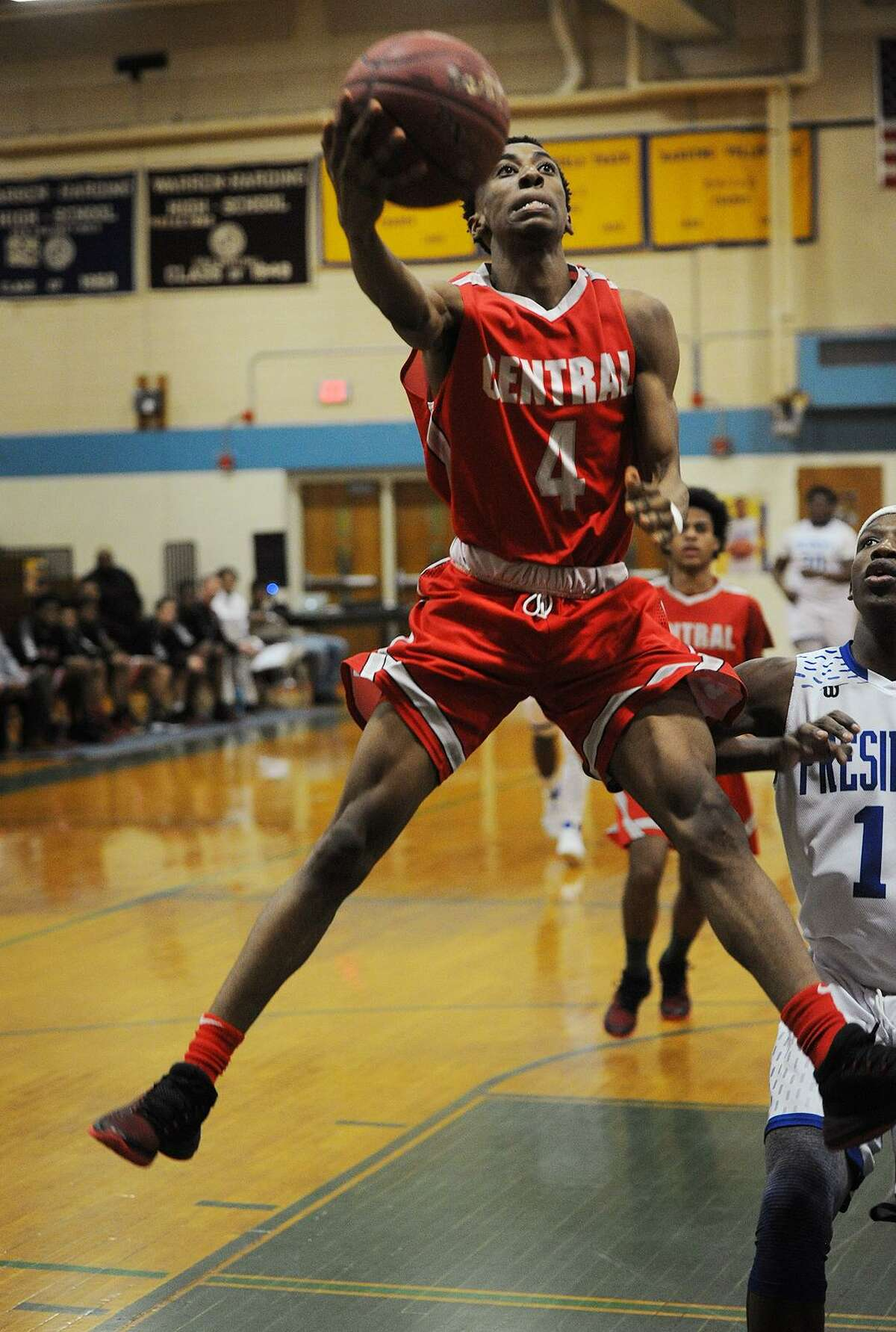 Bridgeport Central's Zack Williams drives to the basket in the first half of their boys basketball game with Harding at Harding High School in Bridgeport, Conn. on Thursday, February 22, 2018. The game was the final regular season game to be played at Miska Gymnasium as the new Harding High School will open next fall.