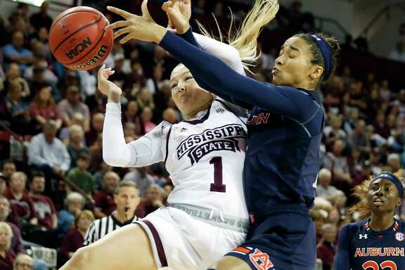 Mississippi State's Blair Schaefer (1) and Auburn's Abigayle Jackson battle for a rebound Thursday at Starkville, Miss. The No. 2 Bulldogs won 82-61.