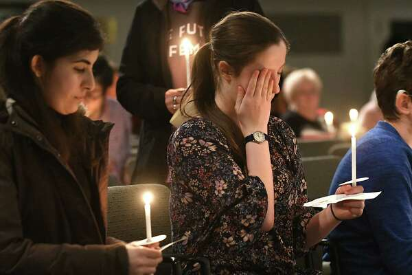 Russell Sage sophomore Isabella Skoufis, center, of Orange County shows emotion during a candlelight vigil to honor the victims of the shooting in Parkland, Florida at the Bush Memorial Center at Russell Sage on Thursday, Feb. 22, 2018 in Colonie, N.Y. (Lori Van Buren/Times Union)