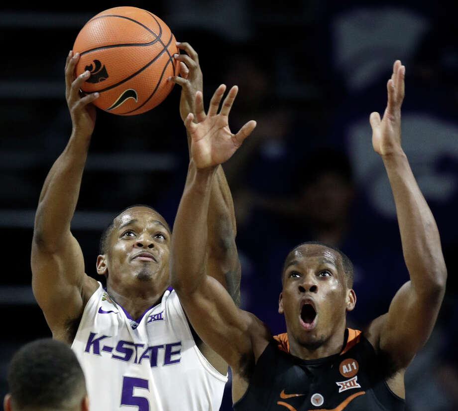 Kansas State guard Barry Brown (5) rebounds against Texas guard Matt Coleman, right, during the first half of an NCAA college basketball game in Manhattan, Kan., Wednesday, Feb. 21, 2018. (AP Photo/Orlin Wagner) Photo: Orlin Wagner, STF / Copyright 2018 The Associated Press. All rights reserved.