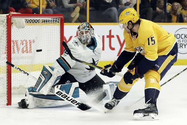 San Jose Sharks goaltender Aaron Dell (30) blocks a shot by Nashville Predators right wing Craig Smith (15) in the second period of an NHL hockey game Thursday, Feb. 22, 2018, in Nashville, Tenn. (AP Photo/Mark Humphrey)