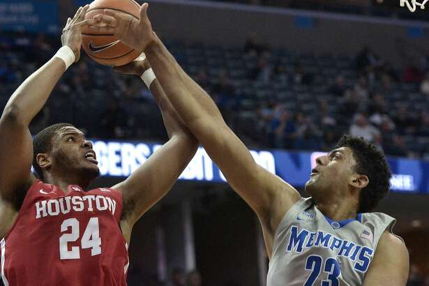 Houston forward Breaon Brady (24) shoots against Memphis forward Karim Sameh Azab (23) in the first half of an NCAA college basketball game Thursday, Feb. 22, 2018, in Memphis, Tenn. (AP Photo/Brandon Dill)