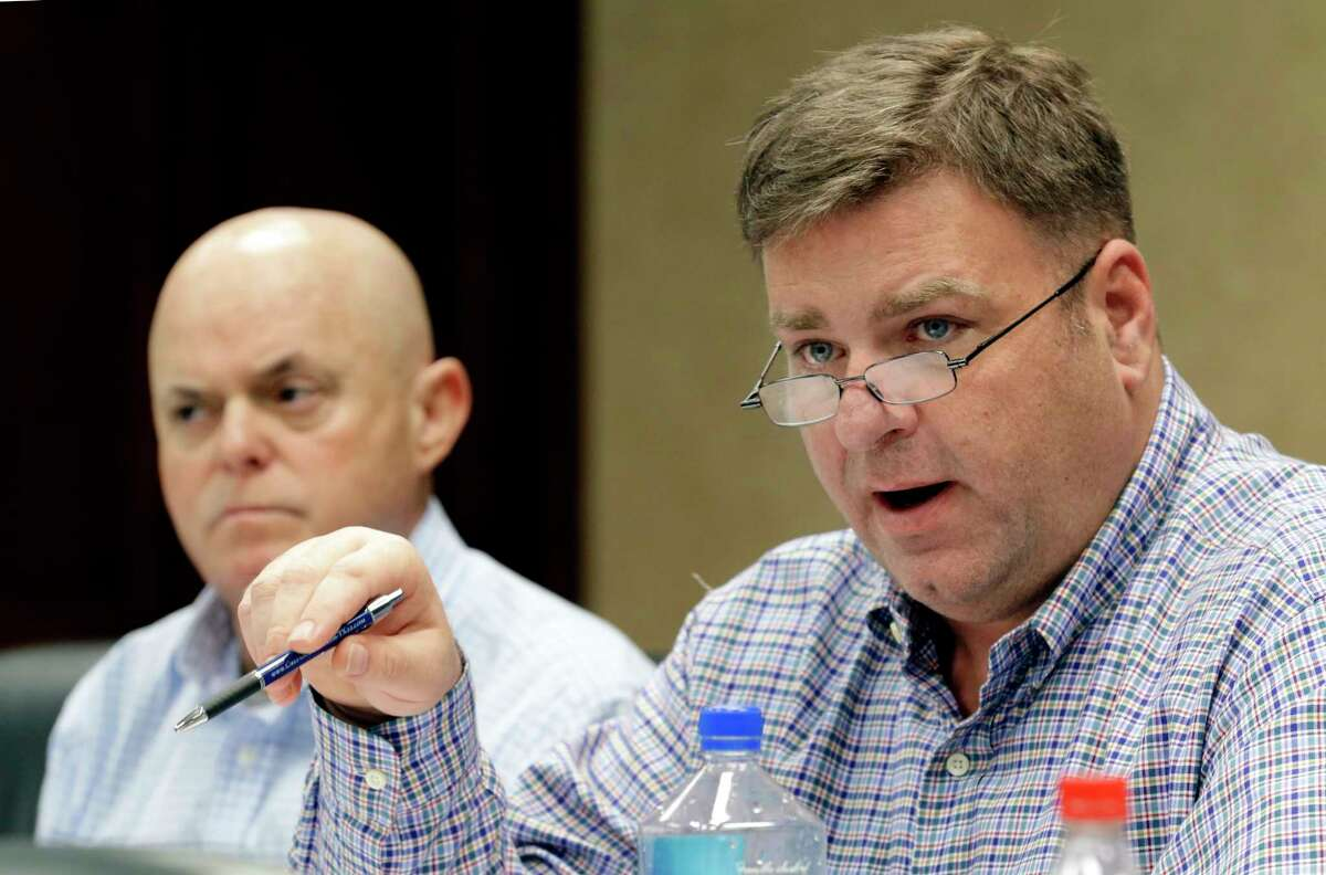 New board members John Arndt listens as James Green asks a question during a meeting of the Fort Bend Flood Management Association at the Fort Bend EDC office in Sugarland, TX, Feb. 9, 2018. (Michael Wyke / For the Chronicle)