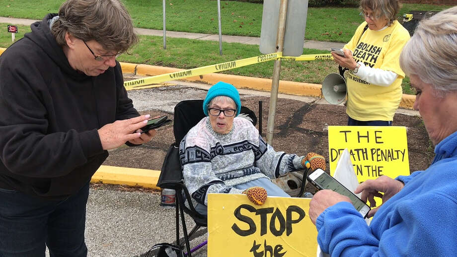 Protestors against the death penalty react to the clemency of inmate Bart Whitaker outside the Huntsville Unit Thursday, Feb. 22, 2018 in Huntsville. Bart Whitaker was scheduled for execution on Thursday and was granted clemency by the governor of Texas.  He was sentenced to death in the murders of his mother, Patricia Whitaker, and his 19-year-old brother, Kevin Whitaker, on December 10, 2003, in Sugar Land. Photo: Houston Chronicle / Houston Chronicle